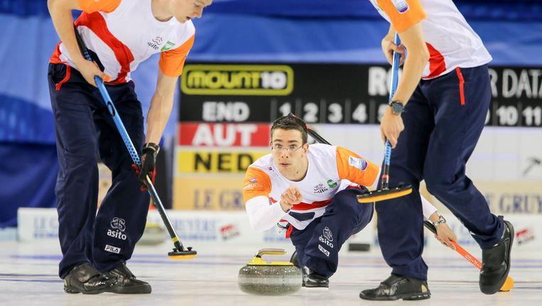 Het Nederlands team in actie op de Europese Kampioenschappen van 2016 in Glasgow. In het midden Jaap van Dorp. Beeld Richard Gray