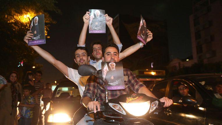 Rohani-aanhangers vieren de overwinning. Beeld Reuters