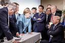 Merkel, Abe en Trump op de vorige top, in Canada.