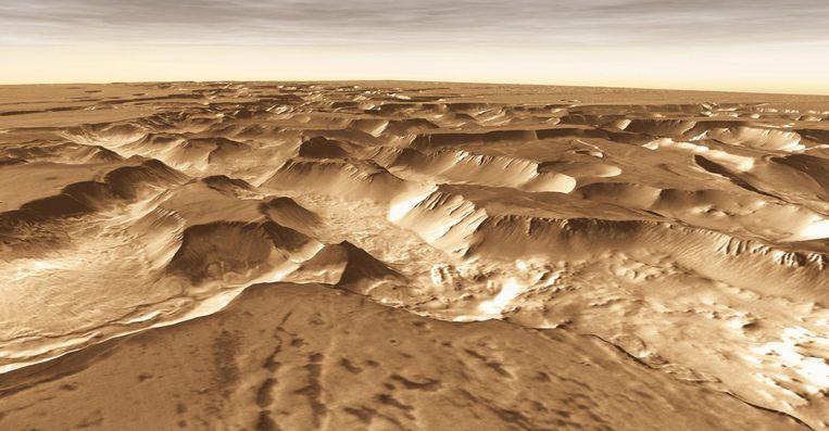 Noctis Labyrinthus op Mars. Een retourtje Mars kost ongeveer twee jaar: achttien maanden heen en weer vliegen plus enkele maanden verblijf op de planeet Beeld UIG via Getty Images