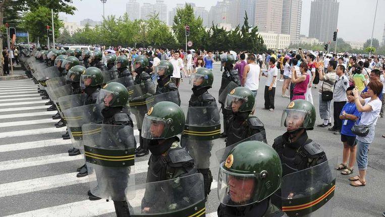Demonstratie op straat in Dalian. Beeld reuters