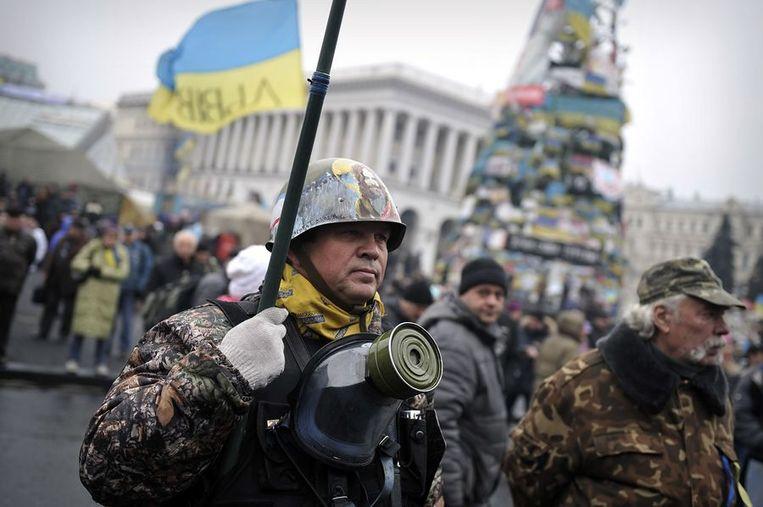 Een zelfbenoemd lid van de 'Maidan zelfverdediging', in Kiev vandaag. Beeld afp