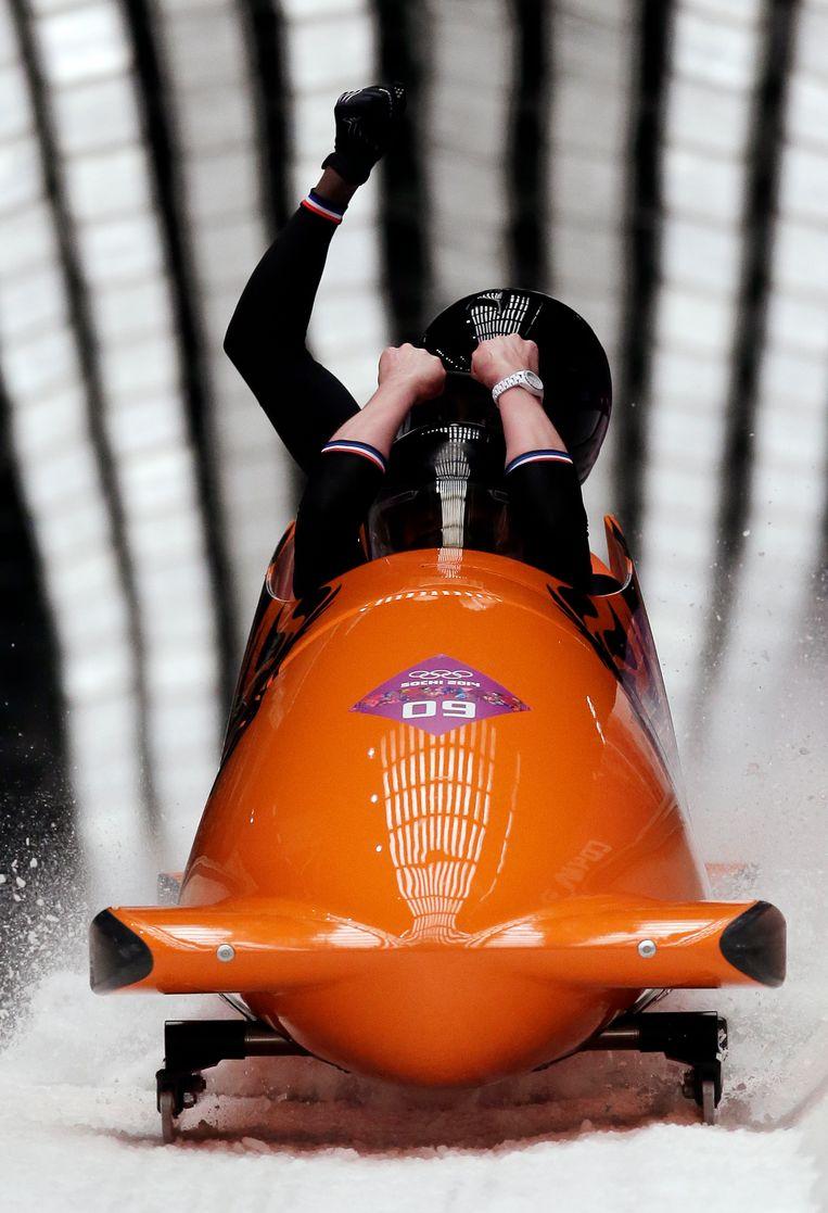 Het Nederlandse bobsleeteam tijdens de Olympische Spelen in Rusland. Beeld ap