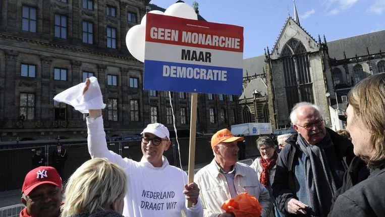 Hans Maessen, campagneleider bij het Nieuw Republikeins Genootschap (NRG), voert actie voor het Paleis op de Dam. Beeld anp