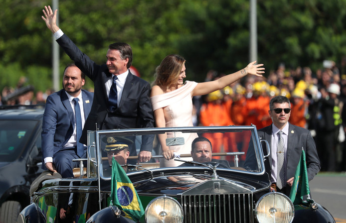 Brazil's new President Jair Bolsonaro and his wife Michelle Bolsonaro, wave to supporters as they drive past after his swearing-in ceremony, in Brasilia, Brazil January 1, 2019. REUTERS/Ricardo Moraes