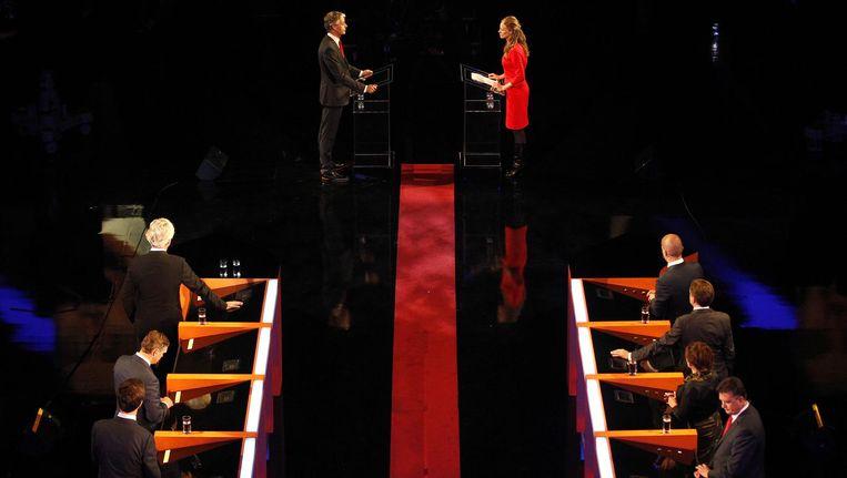 ChristenUnie-lijsttrekker Arie Slob wordt ondervraagd door Petra Grijzen tijdens het Carre-debat van RTL 4 in 2012, waarbij de lijsttrekkers van de acht grootste partijen in debat gingen. Beeld anp