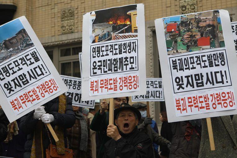 Zuid-Koreanen protesteren tegen Noord-Korea. Beeld afp