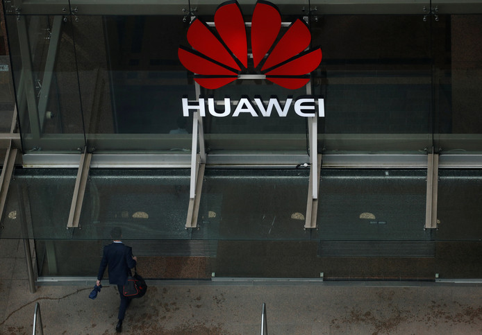 A man walks into the offices of telecommunications company Huawei in Auckland, New Zealand,  October 30, 2018. REUTERS/Phil Noble