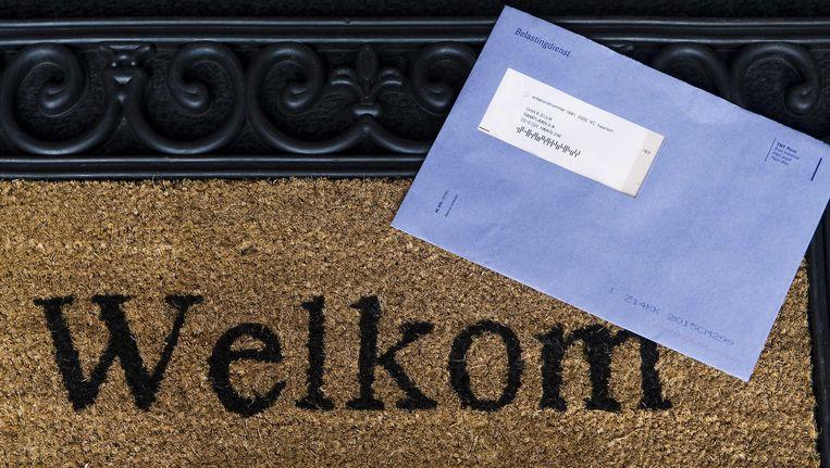 De bekende blauwe envelop van de Belastingdienst. Beeld ANP XTRA
