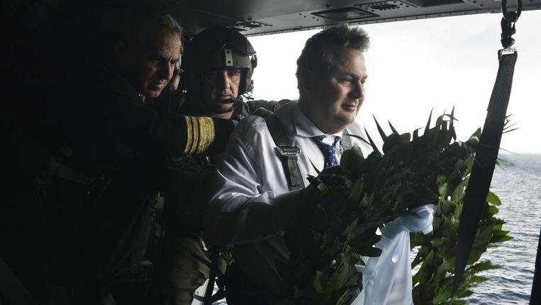 Minister Kammenos eind januari bij een herdenking van de Griekse slachtoffers van een confrontatie met Turkse soldaten in 1996. Beeld ap