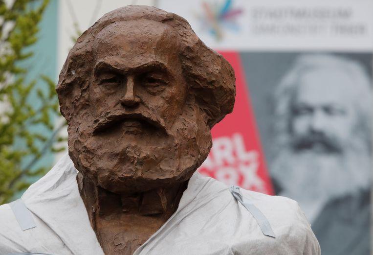 Een standbeeld van Karl Marx in zijn geboortestad Trier. Beeld REUTERS