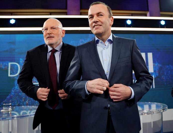 Frans Timmermans (l) en Manfred Weber zijn beide kandidaat om voorzitter van de Europese Commissie te worden.