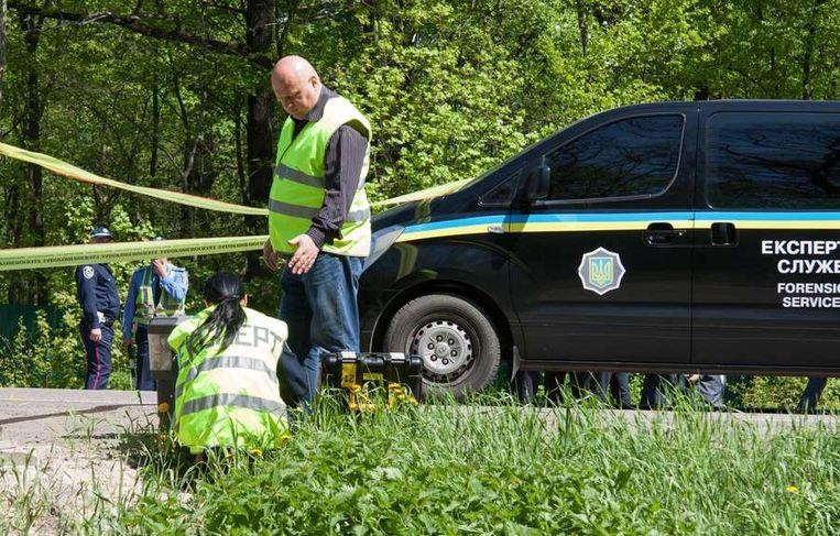De politie deed gisteren sporenonderzoek bij de plek van de aanslag. Beeld afp
