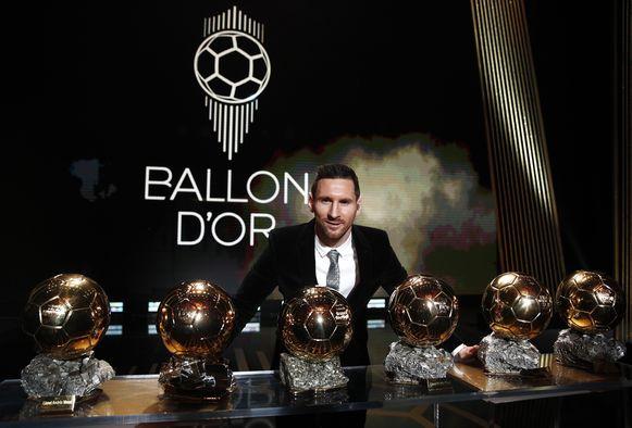 Messi met zijn zes Gouden Ballen.