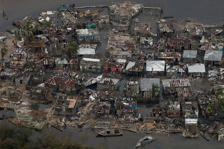 Verwoeste huizen in Corail in Haïti. Beeld REUTERS