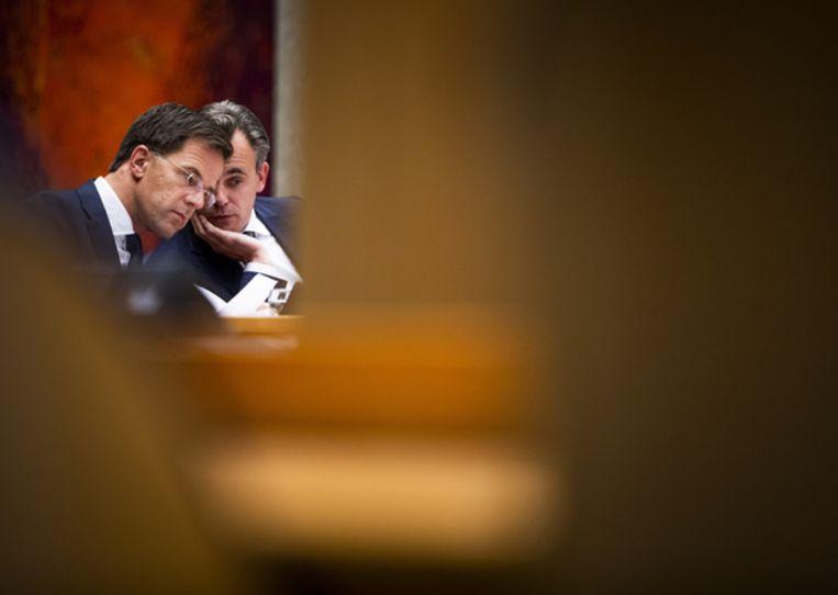 Premier Mark Rutte en staatssecretaris Mark Harbers van Justitie (VVD). Beeld Freek van den Bergh