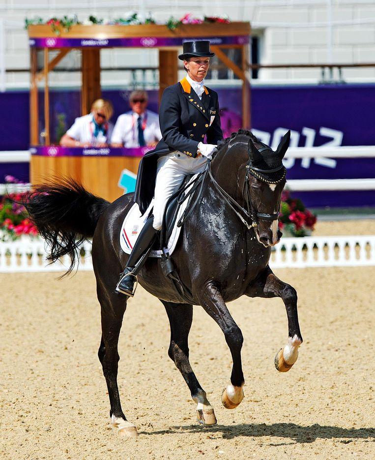 Anky van Grunsven op Salinero tijdens haar proef bij de Grand Prix dressuur op de Olympische Spelen in Londen, 2012. Beeld anp