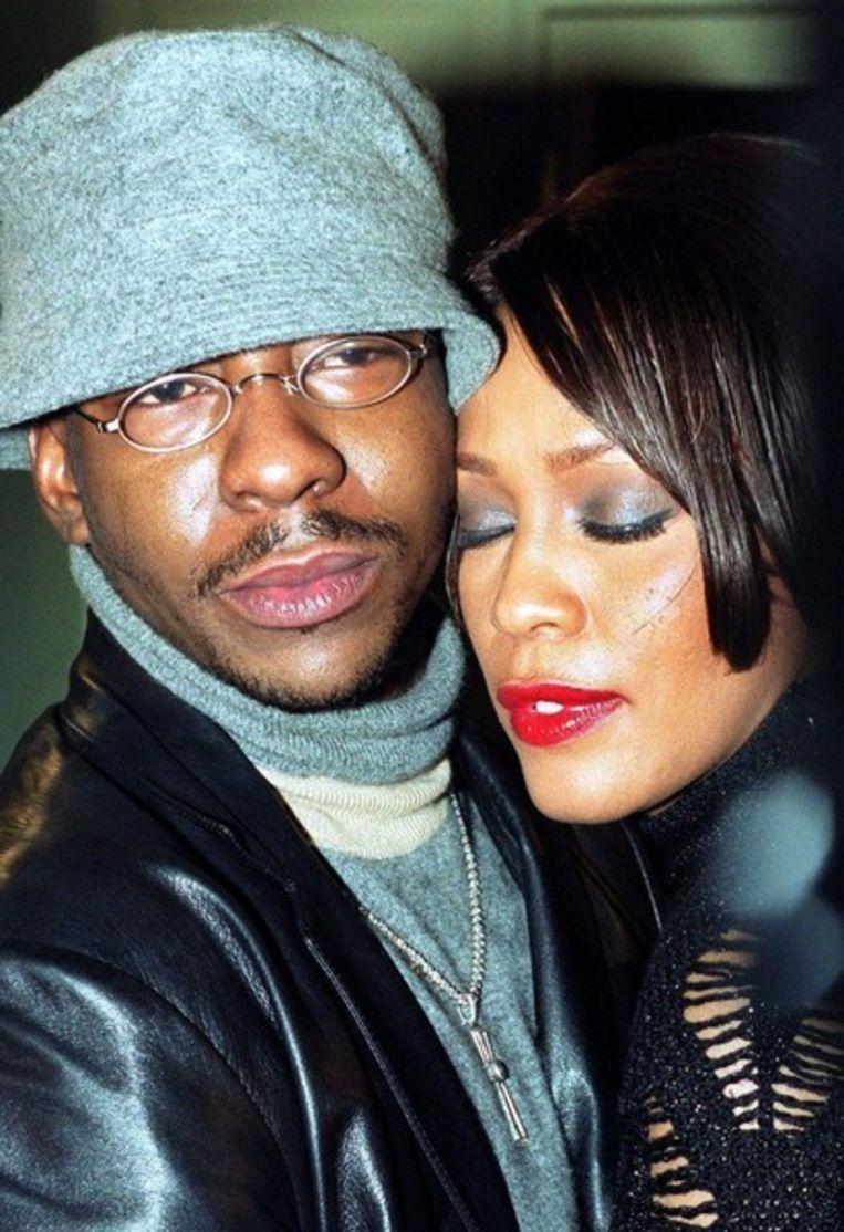 Whitney Houston (r) en Bobby Brown. © Brunopress Beeld