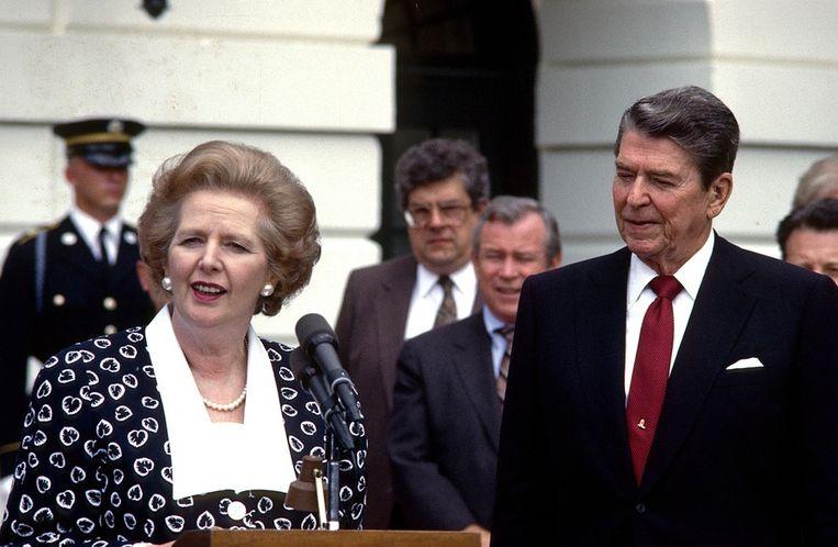 Margaret Thatcher en haar politieke bondgenoot en persoonlijke vriend Ronald Reagan in 1987. Beeld ap