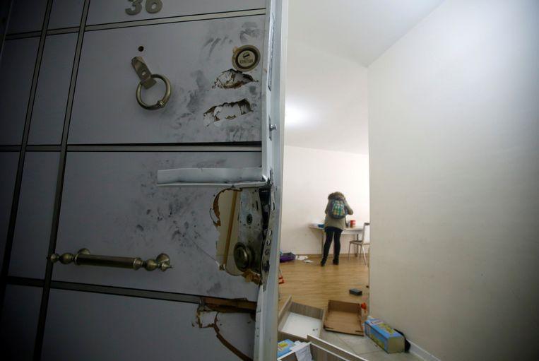 De deur van de verstopplaats van Masharipov. Beeld reuters