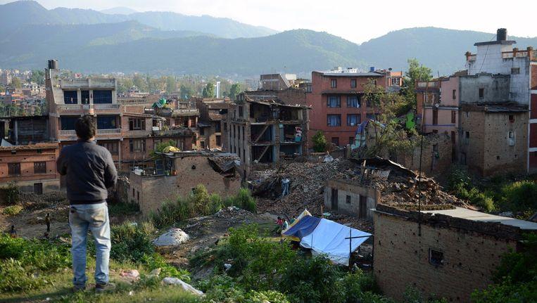 De Nederlandse gemeenschap in Nepal vierde zaterdag Koningsdag, toen een aardbeving de Kathmandu Vallei trof. Beeld afp