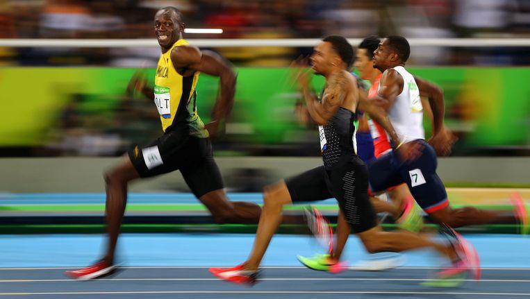 Usain Bolt tijdens de halve finale van de Olympische 100 meter. Beeld photo_news