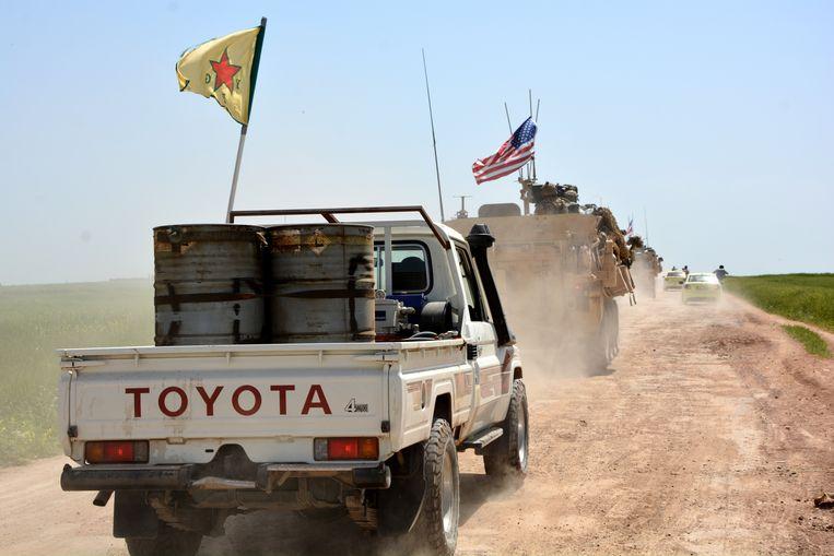 Amerikaanse troepen en de Koerdische Volksbeschermingseenheden (YPG) in Syrië.