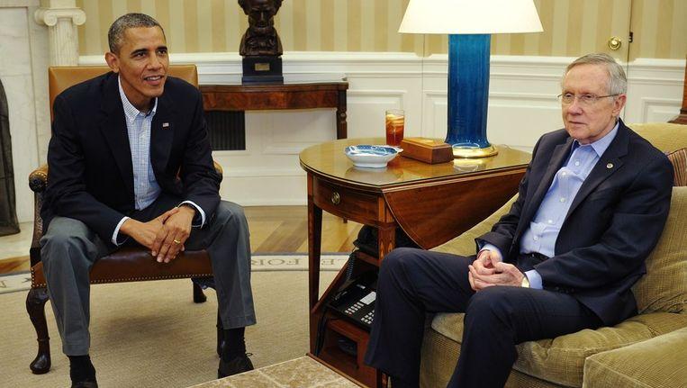 De leider van de Democraten in de Senaat, Harry Reid (rechts), zei dat de Senaat in december alsnog over gaat praten over nieuwe sancties tegen Iran, met of zonder akkoord. Beeld epa