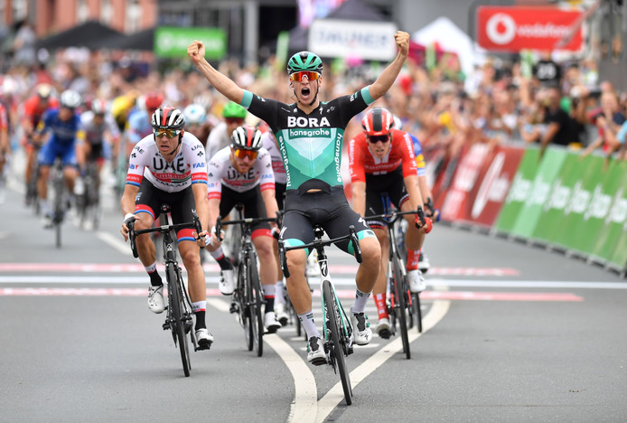 Germany's Pascal Ackermann (C) of team Bora-Hansgrohe celebrates winning the first stage of the UCI Germany Tour from Hanover to Halberstadt, northern Germany on August 29, 2019. (Photo by Bernd Thissen / dpa / AFP) / Germany OUT