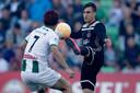 Nicolas Tagliafico in duel met Ritsu Doan van FC Groningen.