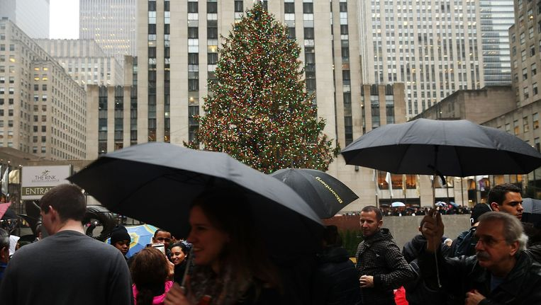 Geen sneeuw maar mild en nat weer in New York. Beeld AFP