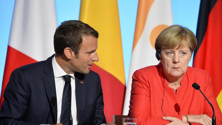 Emmanuel Macron en Angela Merkel Beeld getty