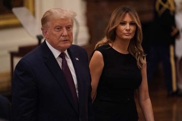 epa08662526 US President Donald J. Trump (L) and First Lady Melania Trump (R) during the Medal of Honor ceremony for Sergeant Major Thomas Payne (not pictured), of the United States Army at the White House, in Washington, DC, USA, 11 September 2020.  EPA/Chris Kleponis / POOL
