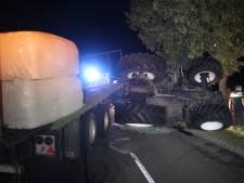 Tractor belandt op kant, bestuurder gewond