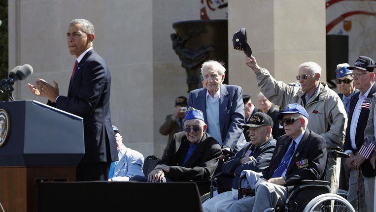 De Amerikaanse president Barack Obama spreekt tijdens een bijeenkomst om D-Day te herdenken. Beeld ap