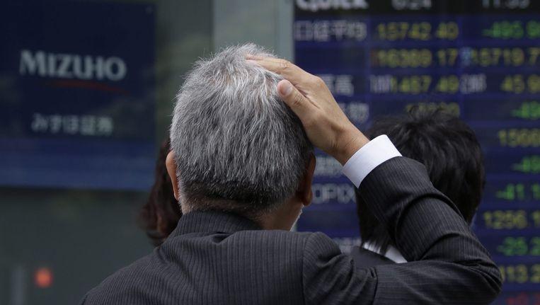 In Japan kelderde de Nikkei-index vanochtend 8 procent nadat de uitslag van het Britse referendum bekend werd Beeld epa