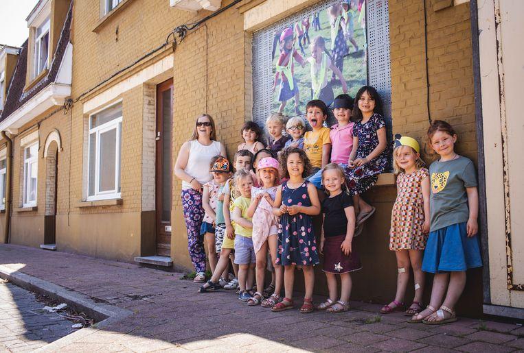De kinderen van Het Tandwiel figureren in het fotoproject.