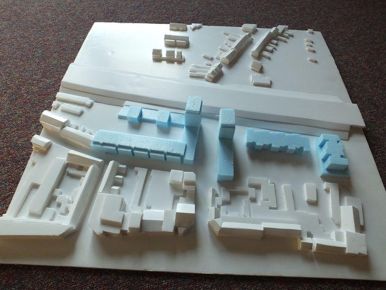 Een maquette van de toekomstige woonwijk met in het blauw links de Torck-site en rechts de Belgacom-site, die in een latere fase zal ontwikkeld worden.