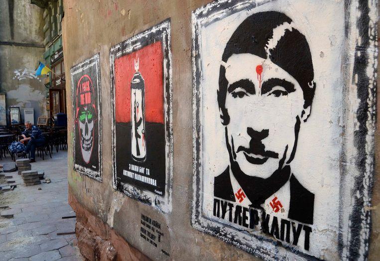 Graffiti met 'Putler' in Lviv, Oekraïne. Beeld REUTERS