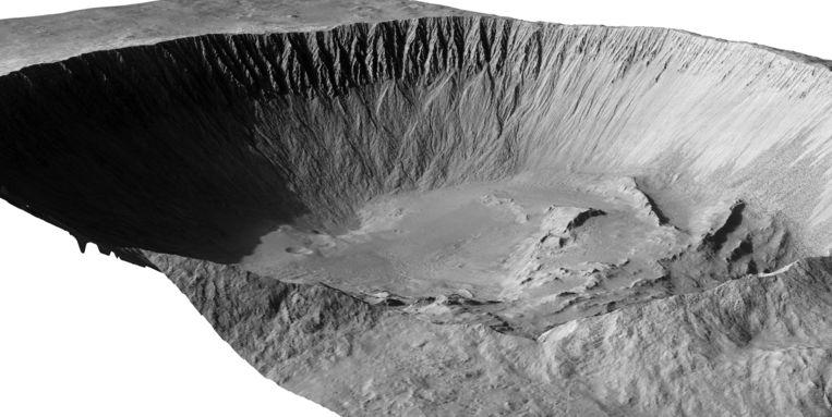 De Istok-krater op het zuidelijke halfrond van Mars, gefotografeerd met een Nasa-verkenner en bewerkt tot een driedimensionaal beeld. De krater is volgens de beste schattingen 190 duizend jaar oud en daarmee zeer jong. Vanaf halverwege de steile wanden aan de overkant zijn puinstromen te zien... Beeld Nasa.