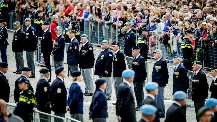 Veteranen op de Dam tijdens de Nationale Dodenherdenking van 2015 Beeld anp
