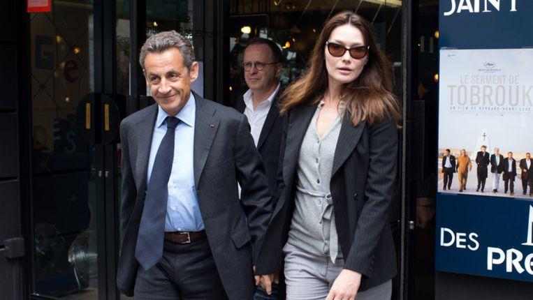 De Franse oud-president Nicolas Sarkozy en zijn vrouw Carla Bruni Beeld afp