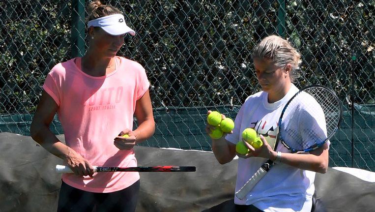 Wickmayer traint met Kim Clijsters op de All England Club.