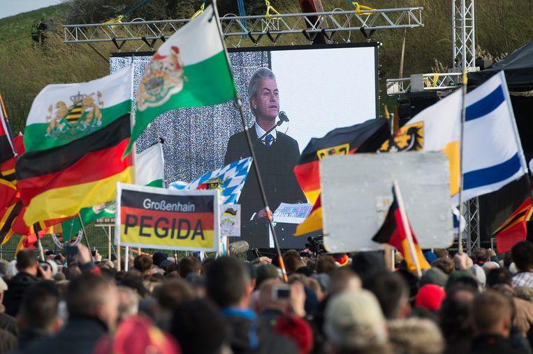 Pegida-aanhangers bij de toespraak van Geert Wilders in Dresden. Beeld epa