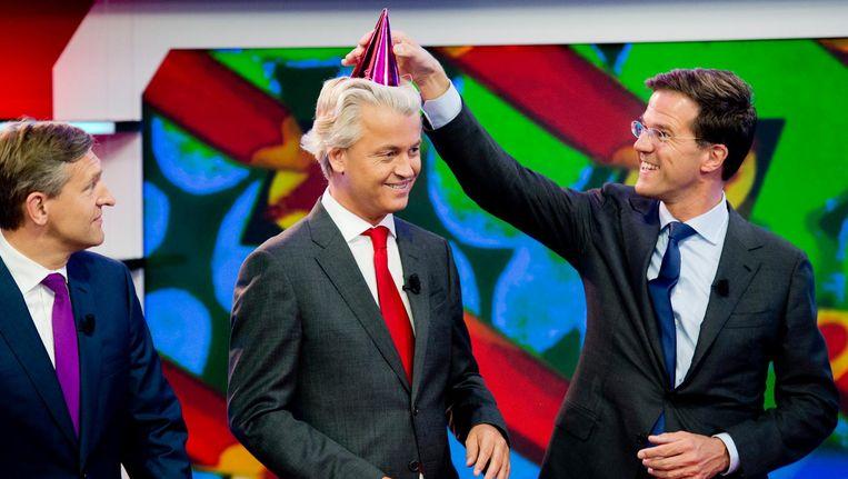 Sybrand Haersma van Buma (CDA), Geert Wilders (PVV) en Mark Rutte (VVD) bij een opname van het Jeugdjournaal Beeld anp
