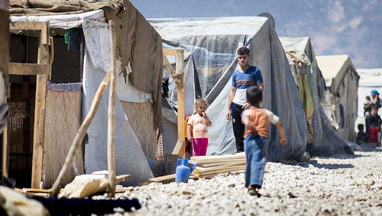 Syrische vluchtelingen in het vluchtelingenkamp Haouch el Harime in de Bekavallei, Libanon. Beeld anp