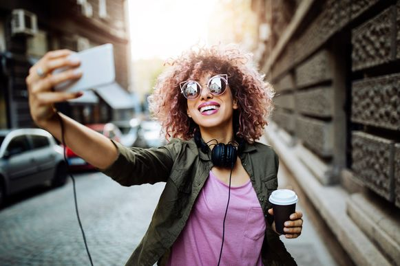 Girl taking a selfie and enjoying her day off