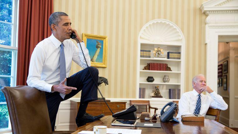 President Obama en vicepresident Biden, gisteren. Beeld AFP