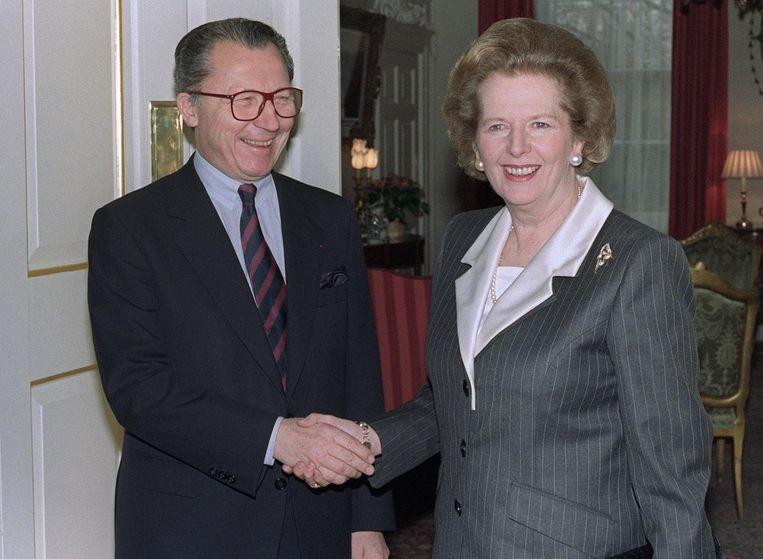 Jacques Delors en Margaret Thatcher op 1 december 1989. De socialist Delors werkte samen met Thatcher aan de vorming van de interne markt in Europa. Beeld anp