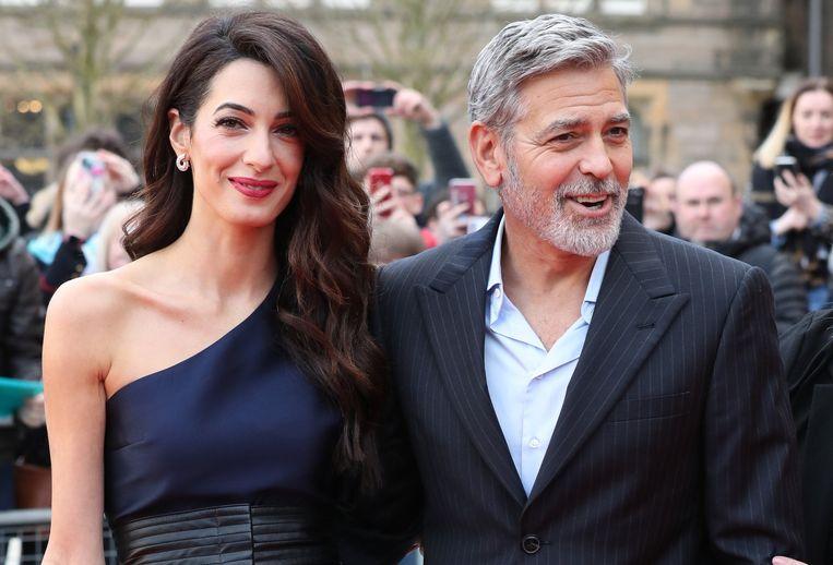George en zijn vrouw Amal Clooney. De twee zijn goed bevriend met Meghan Markle en prins Harry.